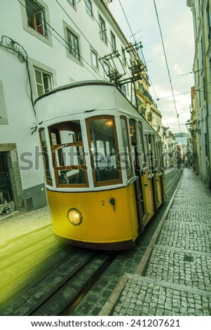 View of the famous vintage electric trams circulating in Lisbon, Portugal.  - stock photo