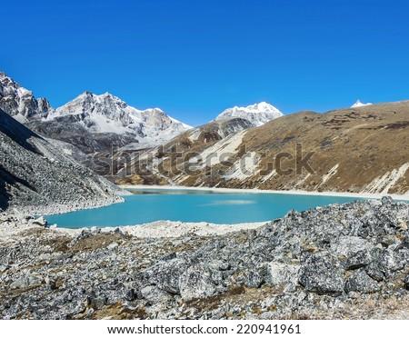 View of the fifth Gokyo lake ( Ngozumba Tsho ) - Everest region, Nepal, Himalayas - stock photo