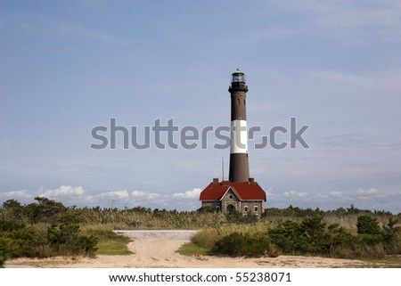 View of the Fire Island Lighthouse as seen from off the main path. - stock photo