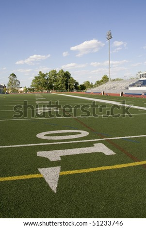 View of the football field from the ten yard line - stock photo