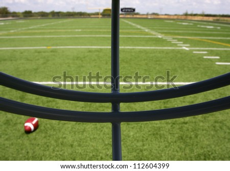 View of the Football Field through the Helmet Face Mask - stock photo