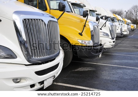 view of the front end of large trucks in a row - stock photo