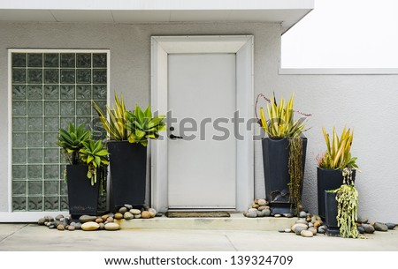 view of the front of a modern home - stock photo
