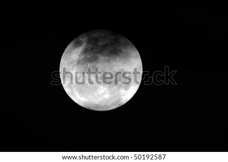 View of the full moon with clouds over the African continent - stock photo