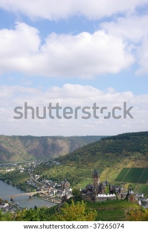 View of the German town of Cochem in the Moselle Valley wine region; vertical format with copy space at top - stock photo