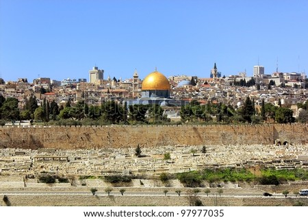 view of the golden dome of Al Aqsa Mosque, the old cemetery, the walls of old Jerusalem