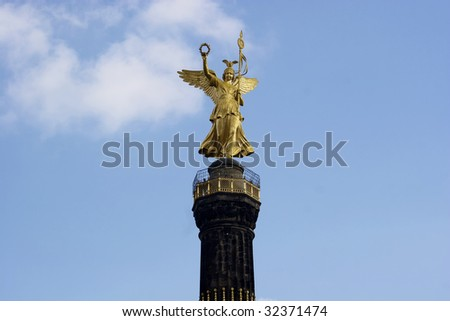 View of the golden statue of winged Victoria on top of the famous Victory Column (Siegessaeule) monument. Berlin, Germany.