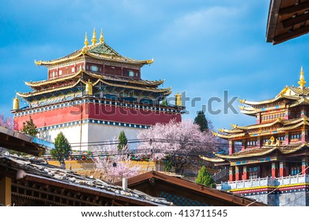view of the golden temple in historical old town in chinese city shangri-la alias zhongdian china - stock photo