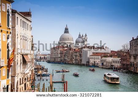 view of the Grand Canal and Basilica Santa Maria della Salute during sunset, Venice, Italy, Europe - stock photo