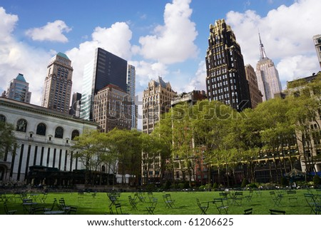 View of the green Brynat park with office buildings as background - stock photo