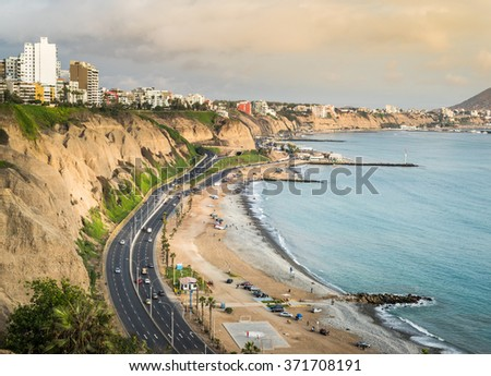 View of the green coast from Miraflores town. - stock photo
