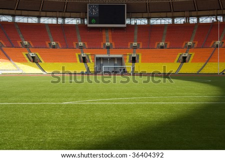 View of the green grassy artificial lawn on football/soccer field - stock photo