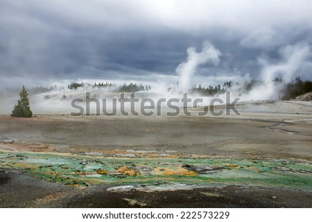 View of the green-yellow river and Norris Geyser Basin in Yellowstone  National Park - stock photo