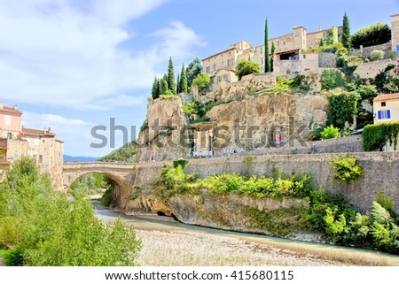 View of the hilltop village of Vaison la Romain and ancient bridge, Provence, France - stock photo
