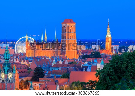 View of the historic center of Gdansk, and St. Mary's Church at night. - stock photo