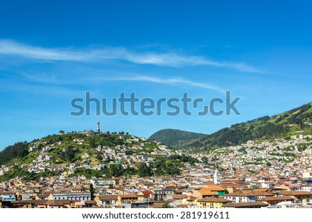View of the historic center of Quito, Ecuador with rolling hills in the background - stock photo