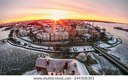 View of the historic city of Vyborg from St. Olav tower, at dawn. Russia. Focus on the central building, photographed on a fisheye lens - stock photo