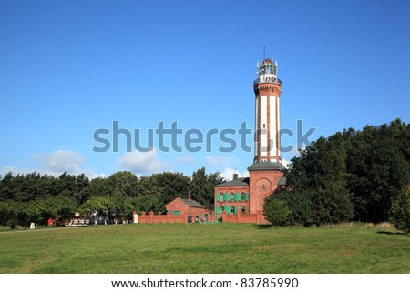 View of the historic lighthouse on the Baltic Sea in Niechorze, Poland, Europe. Lighthouse was built in 1866. - stock photo