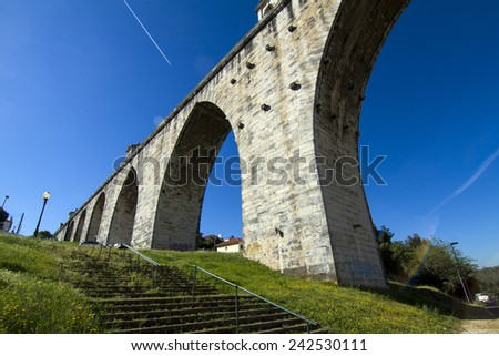 View of the historical aqueduct built in the 18th century, located in Lisbon, Portugal. - stock photo