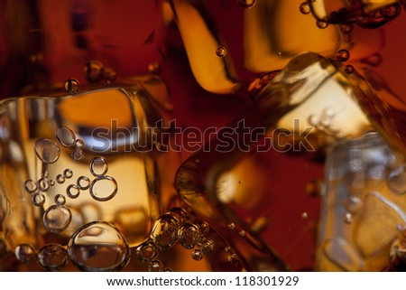 view of the ice cubes in cola background - stock photo