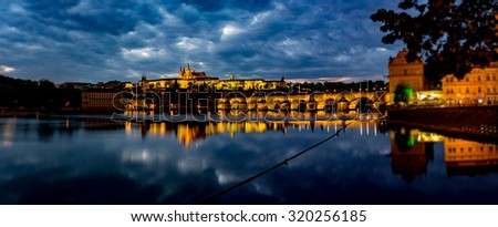 view of the illuminated prague castle and charles bridge in prague