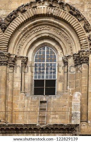 View of the Immovable Ladder on the Church of the Holy Sepulchre in Old City of Jerusalem