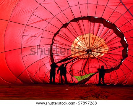 View of the inside of a red hot air balloon being inflated - stock photo