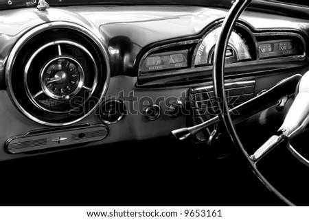 View of the interior of an old vintage car in black and white - stock photo