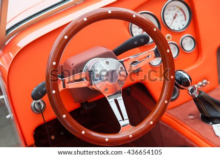 View of the interior of an old vintage car. Steering wheel closeup.