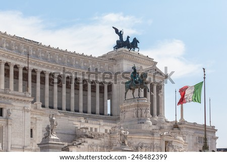 View of the italian national flag in front of Monumento nazionale a Vittorio Emanuele II - stock photo