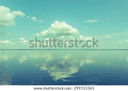 View of the lake at windless weather time. Vintage style image. - stock photo