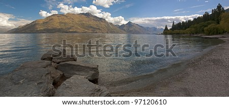 View of the lake from the beach in Queenstown - stock photo
