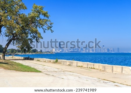 View of the Lake Michigan promenade in Hyde Park with the downtown Chicago skyline in the distance. - stock photo
