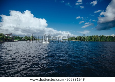 View of the lake on which boat sails sweeps the ship - stock photo