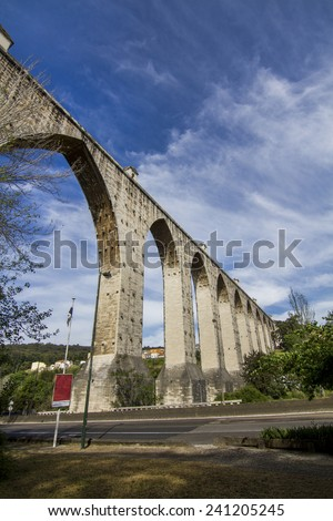 View of the landmark aqueduct located in Lisbon, Portugal. - stock photo
