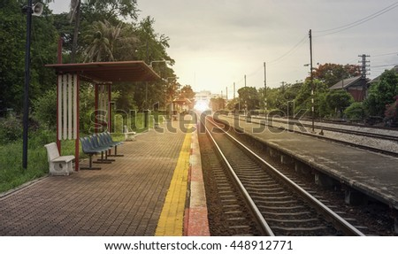 "view of the length of railway with pavement at left side of railway,filtered image, light effect and flare added,selective focus,mean ""Theres light at the end of the tunnel"", success way - stock photo"