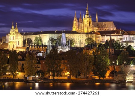 View of the Lesser Bridge Tower of Charles Bridge in Prague (Karluv Most) the Czech Republic. This bridge is the oldest in the city and a very popular tourist attraction. Night photo. - stock photo
