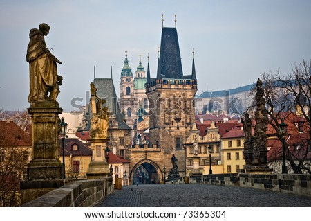 View of the Lesser  Bridge Tower of Charles Bridge in Prague (Karluv Most) the Czech Republic. This bridge is the oldest in the city and a very popular tourist attraction. - stock photo