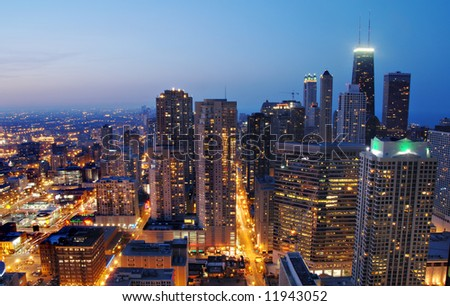 View of the lights of downtown Chicago from the top of Marina Towers at night. View looking down on State Street.