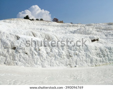 View of the lime-calcium hill surface in Pamukkale in Turkey. - stock photo