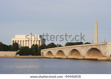 View of the Lincoln Memorial, Memorial Bridge and Washington Monument from the banks of the Potomac River. - stock photo