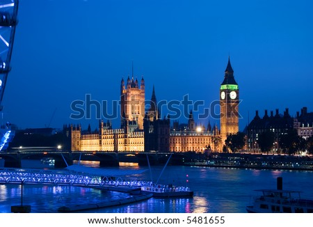 view of the london eye and big ben at dusk - stock photo
