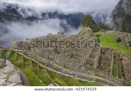 View of the Lost Incan City of Machu Picchu near Cusco.Low clouds cover mountains.Cusco Region,Sacred Valley, Peru - stock photo