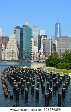 View of the Lower Manhattan from Brooklyn Bridge Park. - stock photo