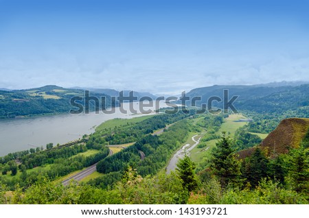 View of the lush green Columbia River Gorge in Oregon with I-84 visible - stock photo