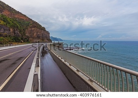View of the magestic Sea Cliff Bridge and surrounding landscape of Grand Pacific Drive, Sydney, Australia. - stock photo