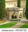 View of the main cloister. The Royal Abbey of Santa Maria de Poblet, Spain, UNESCO World Heritage Site - This Cistercian abbey in Catalonia is one of the largest in Spain. - stock photo