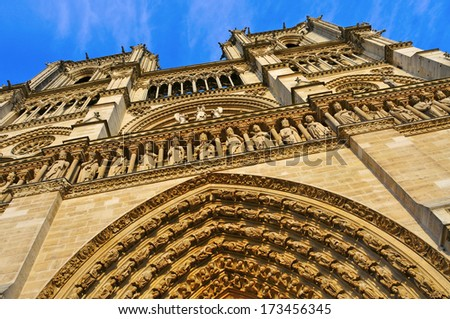 view of the main facade of Notre-Dame Cathedral in Paris, France - stock photo