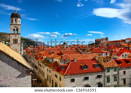 View of the main street of Dubrovnik and classic red tiled rooftops of city - stock photo