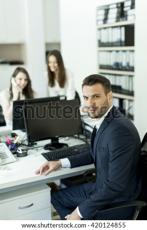 View of the man sitting at the desk in the office